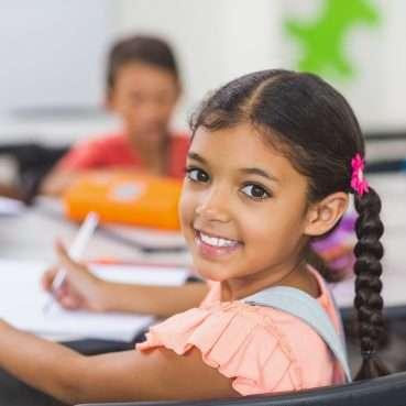 reflex atnr palmar planta Portrait of schoolgirl in classroom